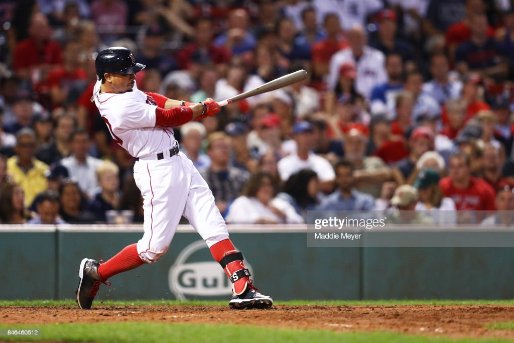 Mookie Betts #50 of the Boston Red Sox hits a two run home run against the Oakland Athletics during the sixth inning at Fenway Park on September 12, 2017 in Boston, Massachusetts.
