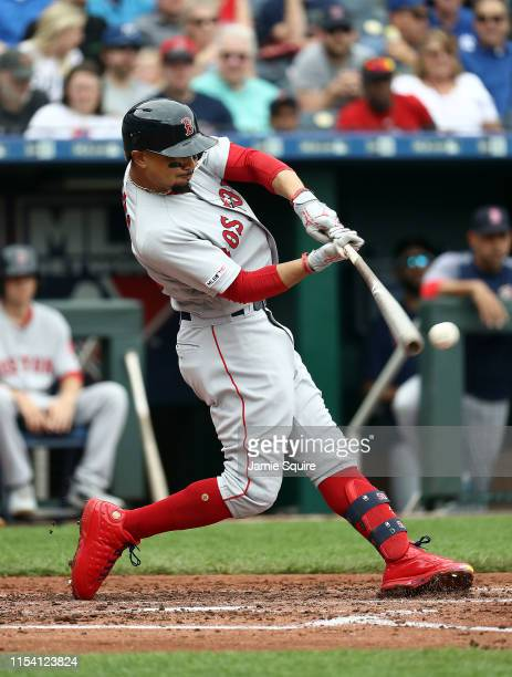 Mookie Betts of the Boston Red Sox hits a two run home run during the 3rd inning of the game against the Kansas City Royals at Kauffman Stadium on...