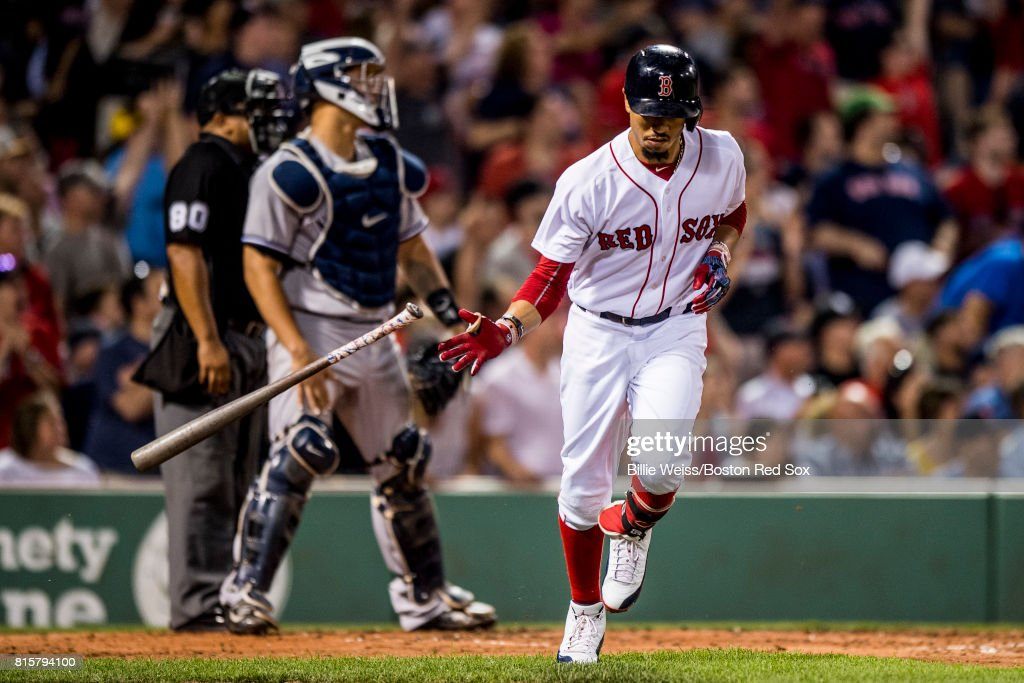 Mookie Betts #50 of the Boston Red Sox hits a two run home run during the third inning of a game against the New York Yankees on July 16, 2017 at Fenway Park in Boston, Massachusetts.