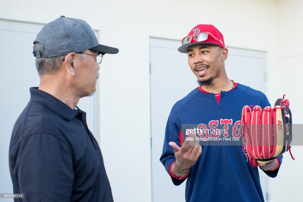 Mookie Betts #50 of the Boston Red Sox holds a Wilson glove during a team workout on February 21, 2018 at jetBlue Park at Fenway South in Fort Myers, Florida .