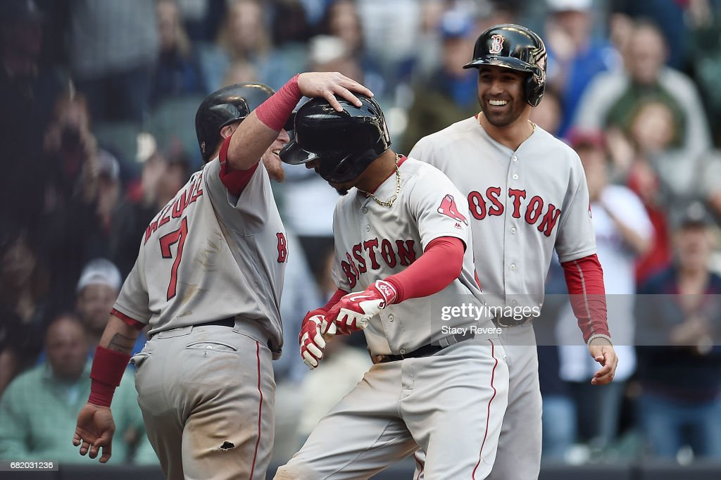 Mookie Betts #50 of the Boston Red Sox is congratulated by Christian Vazquez #7 following a ninth inning home run against the Milwaukee Brewers at Miller Park on May 11, 2017 in Milwaukee, Wisconsin.