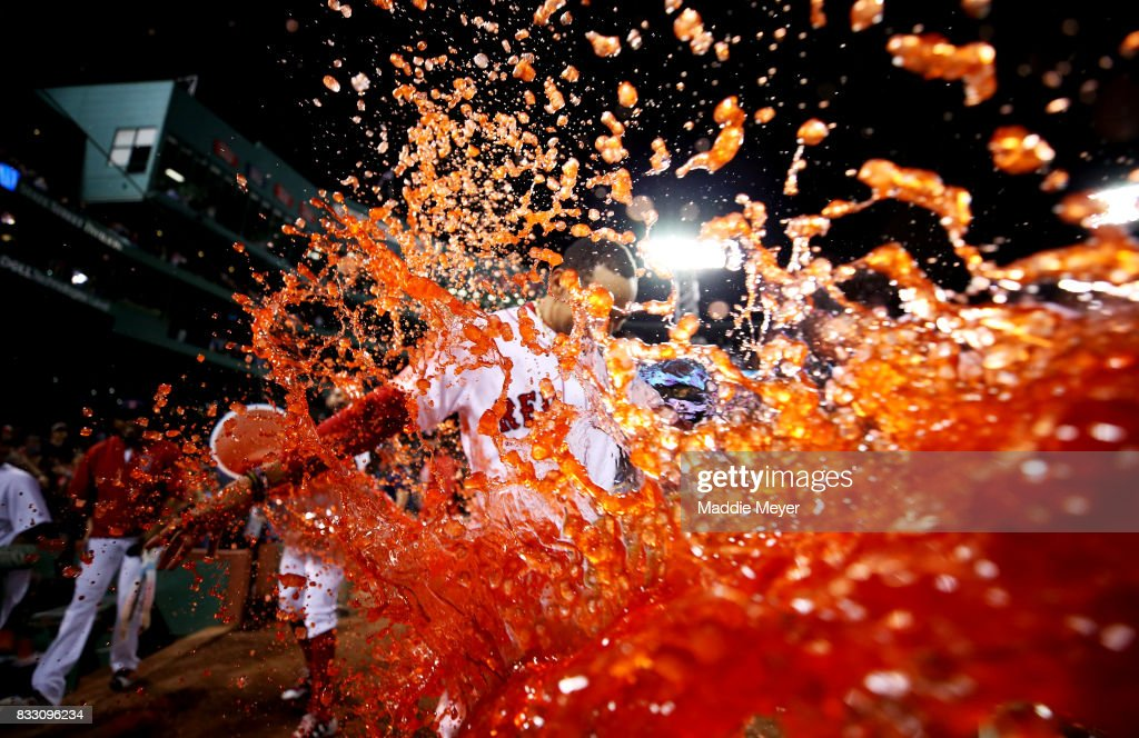 Mookie Betts #50 of the Boston Red Sox is doused in Powerade after hitting a walk off two run double to defeat the St. Louis Cardinals 5-4 at Fenway Park on August 16, 2017 in Boston, Massachusetts.