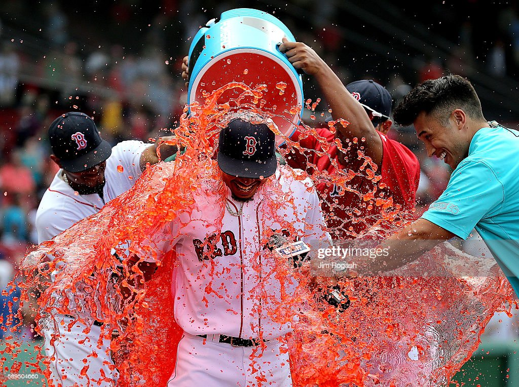 Mookie Betts #50 of the Boston Red Sox is doused with Powerade during an interview after he hit three home runs to help defeat the the Arizona Diamondbacks, 16-2, at Fenway Park on August 14, 2016 in Boston, Massachusetts.
