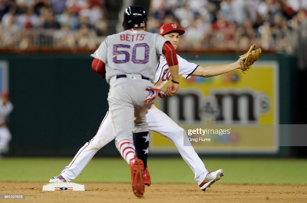 Mookie Betts #50 of the Boston Red Sox is forced out at second base in the ninth inning by Trea Turner #7 of the Washington Nationals at Nationals Park on July 3, 2018 in Washington, DC.