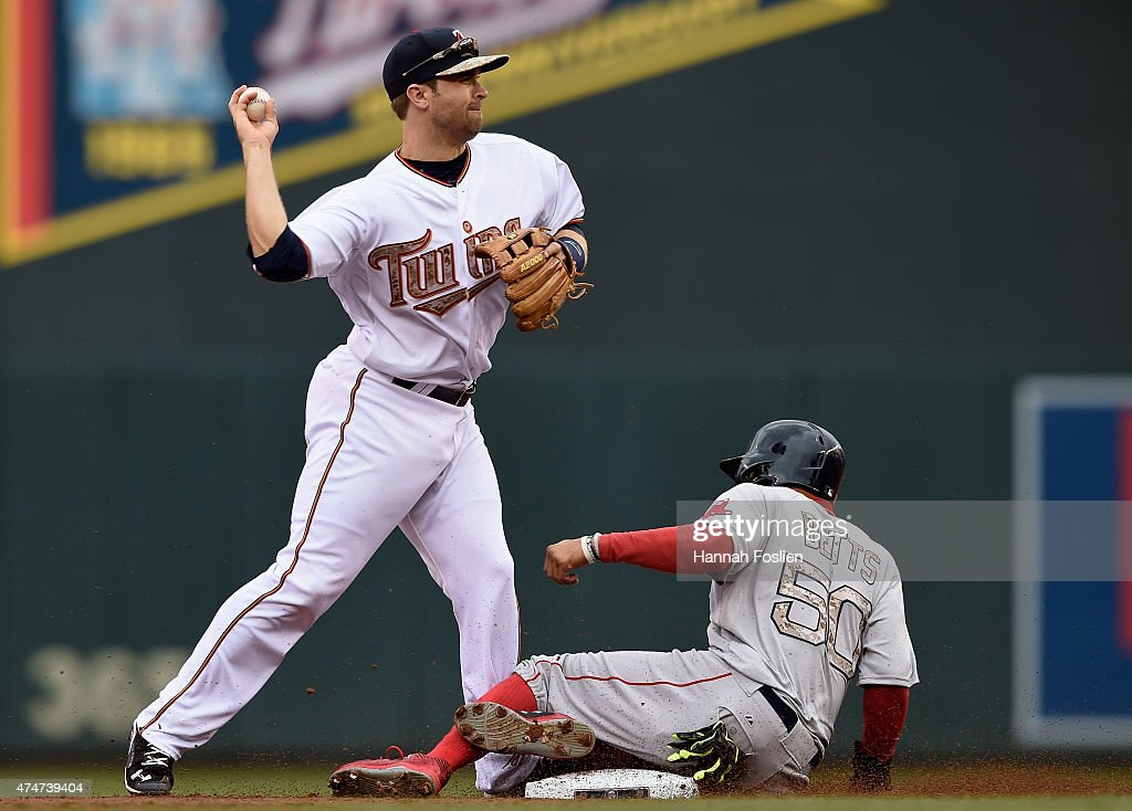 Mookie Betts #50 of the Boston Red Sox is out at second base as Brian Dozier #2 of the Minnesota Twins turns a double play in the first inning of the game on May 25, 2015 at Target Field in Minneapolis, Minnesota. The Twins defeated the Red Sox 7-2.