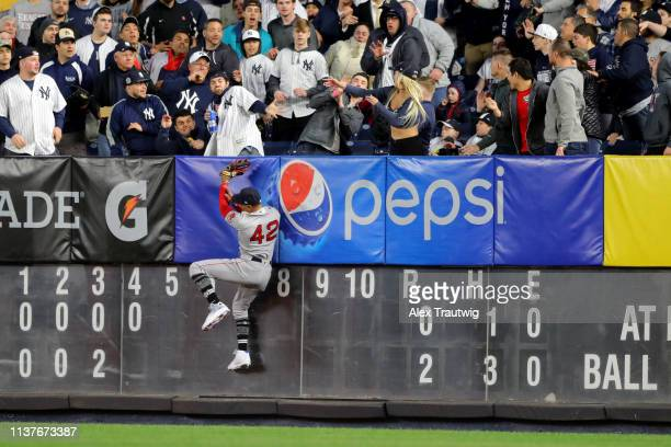 Mookie Betts of the Boston Red Sox is unable to make the play on a Clint Frazier of the New York Yankees solo home run in the fourth inning during...
