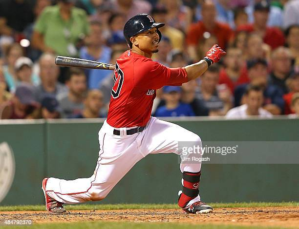 Mookie Betts of the Boston Red Sox knocks in a run against the Kansas City Royals in the fourth inning at Fenway Park on August 21 2015 in Boston...