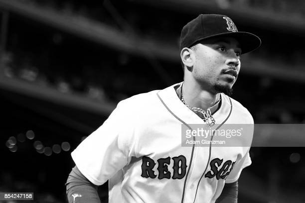 Mookie Betts of the Boston Red Sox looks on before a game against the Toronto Blue Jays at Fenway Park on September 25 2017 in Boston Massachusetts