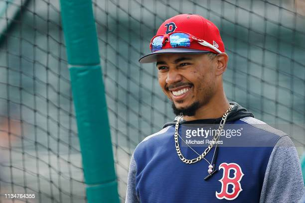 Mookie Betts of the Boston Red Sox looks on during batting practice prior to the Grapefruit League spring training game against the New York Mets at...