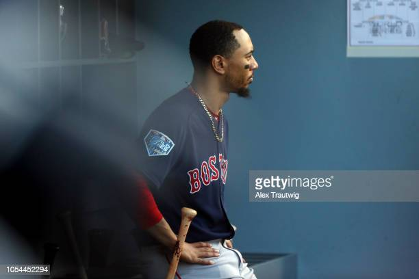 Mookie Betts of the Boston Red Sox looks on from the dugout during Game 4 of the 2018 World Series against the Los Angeles Dodgers at Dodger Stadium...