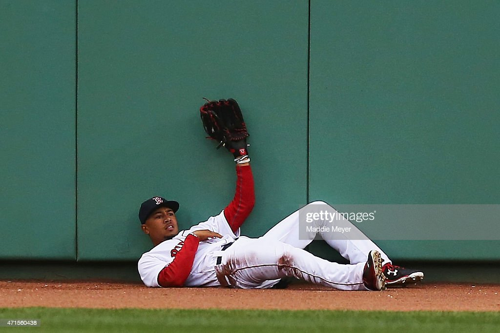 Mookie Betts #50 of the Boston Red Sox makes a catch during the third inning against the Toronto Blue Jays at Fenway Park on April 29, 2015 in Boston, Massachusetts.