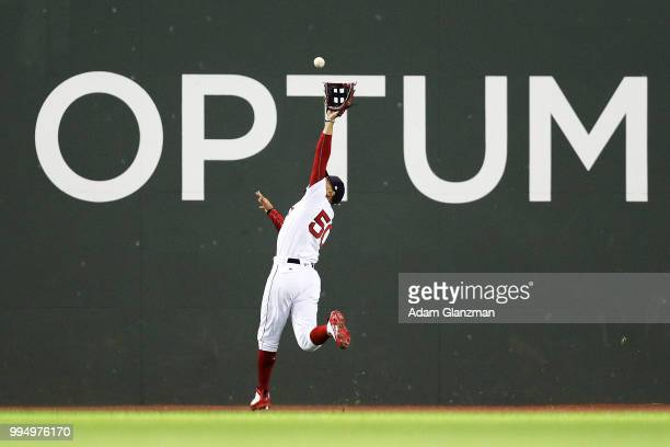 Mookie Betts of the Boston Red Sox makes a leaping catch in the fifth inning of a gam against the Texas Rangers at Fenway Park on JULY 9 2018 in...
