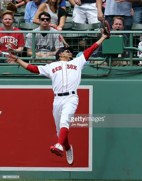 Mookie Betts of the Boston Red Sox makes a leaping catch on a ball hit by Mitch Haniger of the Seattle Mariners in the sixth inning at Fenway Park on...