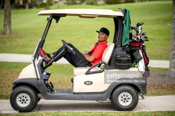 Mookie Betts of the Boston Red Sox poses for a photograph in a golf cart during a Golf Tournament on February 21 2017 at Fenway South in Fort Myers...