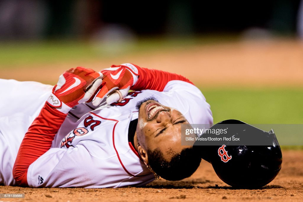Mookie Betts #50 of the Boston Red Sox reacts after an injury during the seventh inning of a game against the Baltimore Orioles on May 3, 2017 at Fenway Park in Boston, Massachusetts.