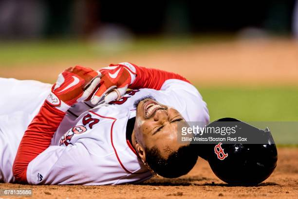 Mookie Betts of the Boston Red Sox reacts after an injury during the seventh inning of a game against the Baltimore Orioles on May 3, 2017 at Fenway...
