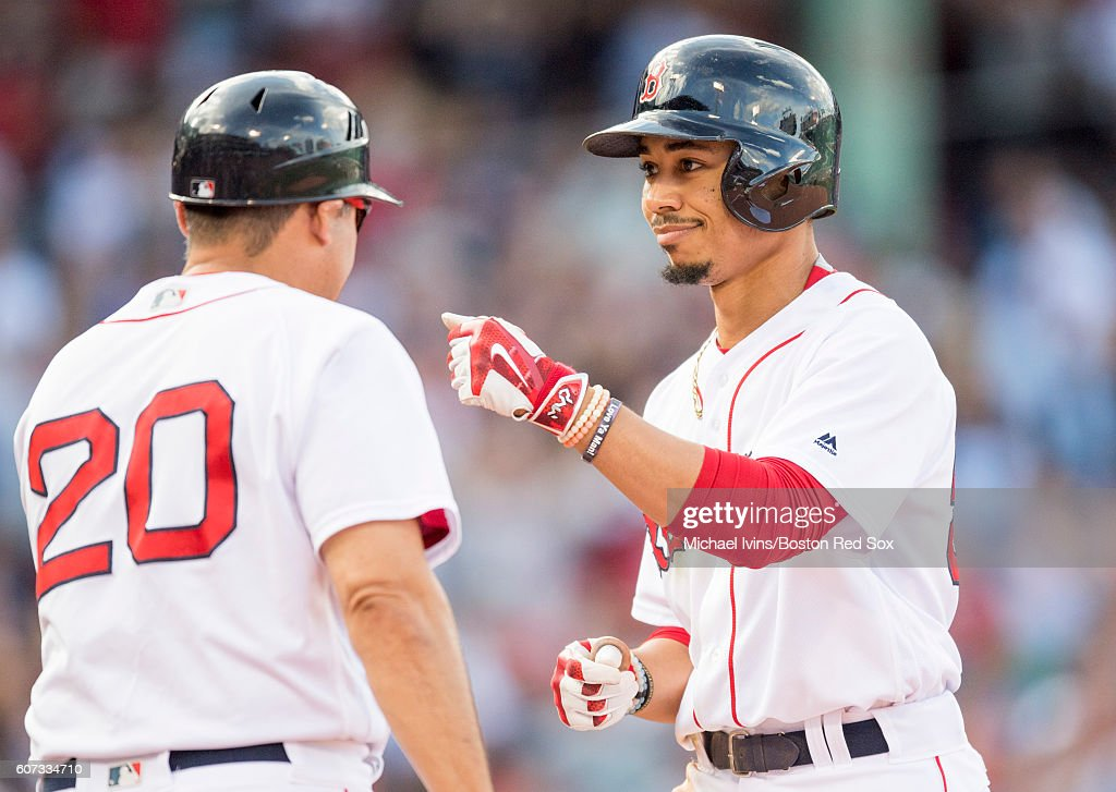 Mookie Betts #50 of the Boston Red Sox reacts after an RBI single tied the game at five apiece against the New York Yankees in the seventh inning on September 17, 2016 at Fenway Park in Boston, Massachusetts.