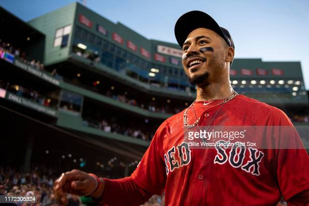 Mookie Betts of the Boston Red Sox reacts after being doused by Gatorade after scoring the game winning run on a walk-off single hit by Rafael Devers...