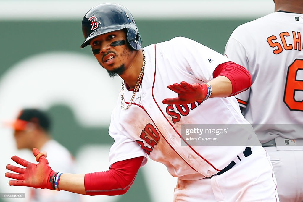 Mookie Betts #50 of the Boston Red Sox reacts after hitting a double in the third inning of a game against the Baltimore Orioles at Fenway Park on May 20, 2018 in Boston, Massachusetts.