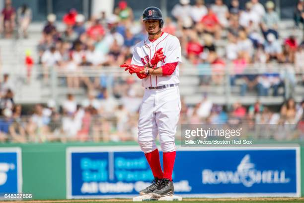 Mookie Betts of the Boston Red Sox reacts after hitting a double during the fifth inning of a Spring Training game against the Atlanta Braves on...
