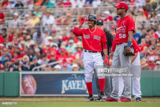 Mookie Betts of the Boston Red Sox reacts after hitting a single during the first inning of a Spring Training game against the St Louis Cardinals on...