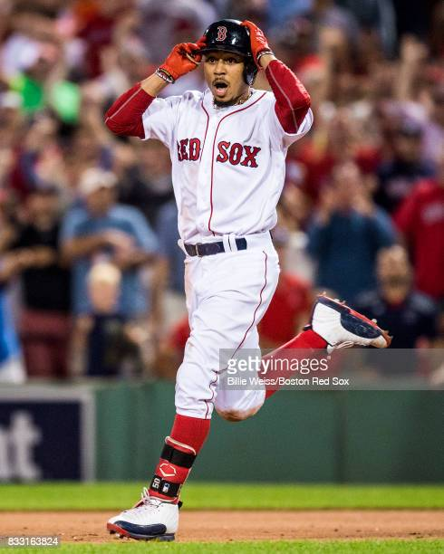 Mookie Betts of the Boston Red Sox reacts after hitting the gamewinning walkoff double during the ninth inning of a game against the St Louis...