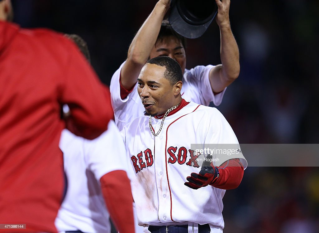 Mookie Betts #50 of the Boston Red Sox reacts after singling in the winning run in the ninth inning against the Toronto Blue Jays at Fenway Park April 27, 2015 in Boston, Massachusetts.