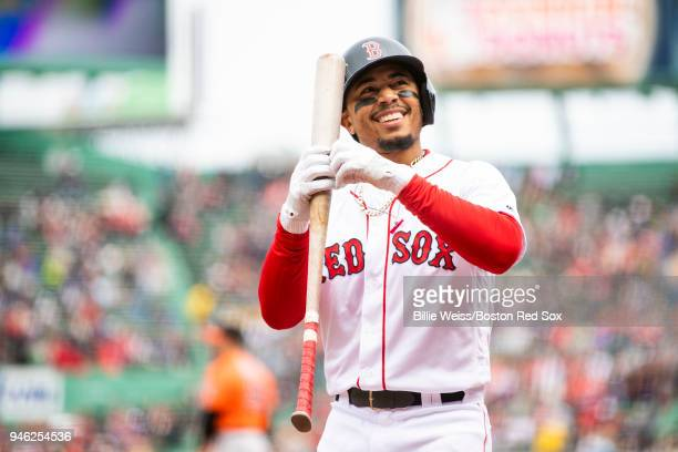 Mookie Betts of the Boston Red Sox reacts during the first inning of a game against the Baltimore Orioles on April 14 2018 at Fenway Park in Boston...