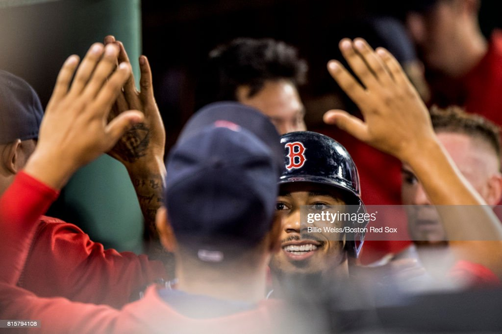 Mookie Betts #50 of the Boston Red Sox reacts with teammates after hitting a two run home run during the third inning of a game against the New York Yankees on July 16, 2017 at Fenway Park in Boston, Massachusetts.