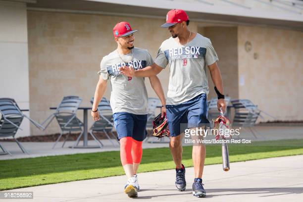 Mookie Betts of the Boston Red Sox reacts with Xander Bogaerts as they exit the clubhouse during a team workout on February 14 2018 at Fenway South...