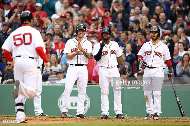 Mookie Betts of the Boston Red Sox rounds the bases after hitting a grand slam in the seventh inning during the game against the Cleveland Indians at...
