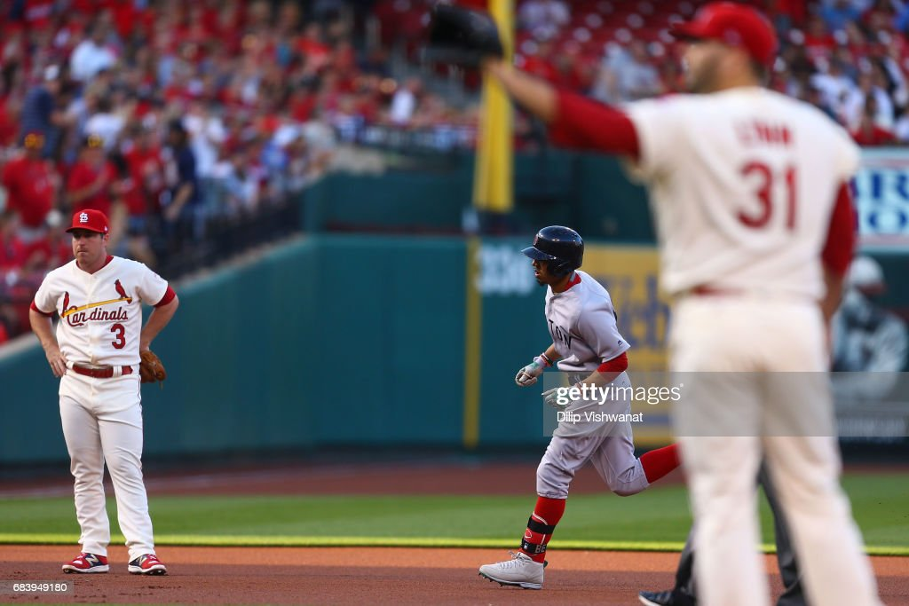 Mookie Betts #50 of the Boston Red Sox rounds the bases after hitting a home run as Jedd Gyorko #3 and Lance Lynn #31 of the St. Louis Cardinals react in the first inning at Busch Stadium on May 16, 2017 in St. Louis, Missouri.