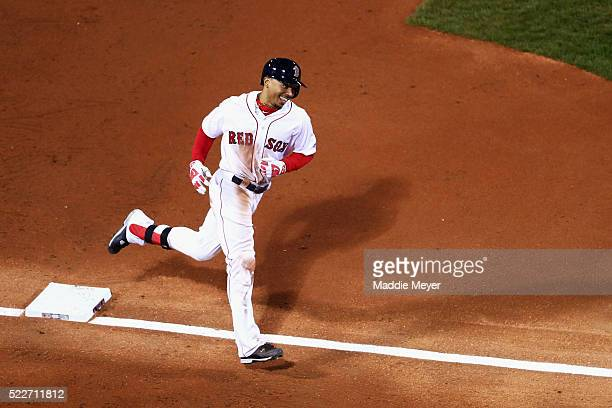 Mookie Betts of the Boston Red Sox rounds third on his way to score after hitting a tworun homer during the second inning against the Tampa Bay Rays...