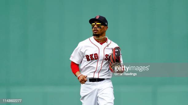 Mookie Betts of the Boston Red Sox runs in from the outfield during the game against the Baltimore Orioles at Fenway Park on April 14 2019 in Boston...