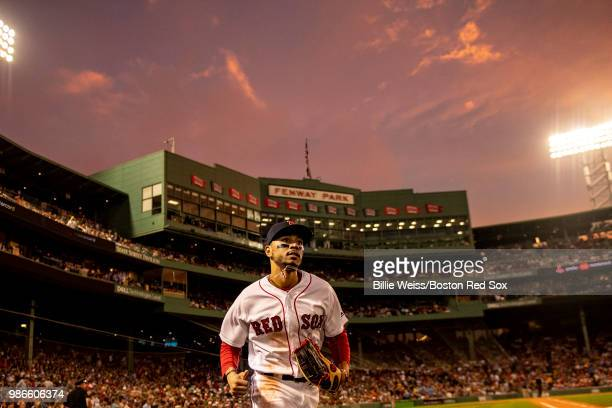 Mookie Betts of the Boston Red Sox runs onto the field as the sun sets during the fifth inning of a game against the Los Angeles Angels of Anaheim on...