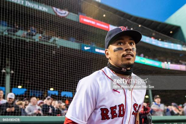 Mookie Betts of the Boston Red Sox runs onto the field before a game against the New York Yankees on April 12 2018 at Fenway Park in Boston...