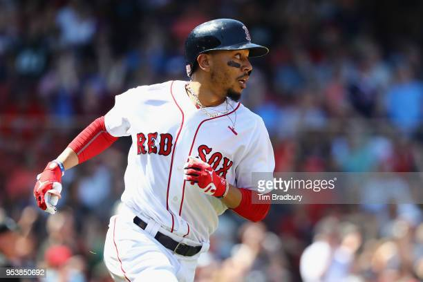 Mookie Betts of the Boston Red Sox runs the bases after hitting a solo home run during the fourth inning against the Kansas City Royals at Fenway...