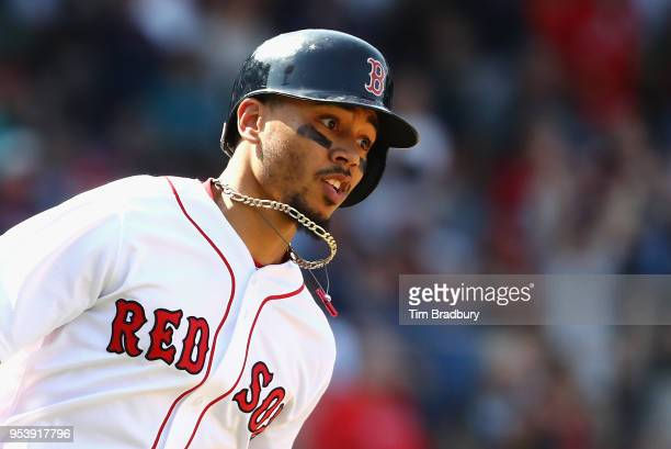 Mookie Betts of the Boston Red Sox runs the bases after hitting a solo home run during the seventh inning against the Kansas City Royals at Fenway...