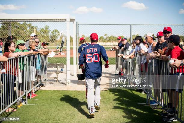 Mookie Betts of the Boston Red Sox runs to a different field during a team workout on February 19 2018 at jetBlue Park at Fenway South in Fort Myers...