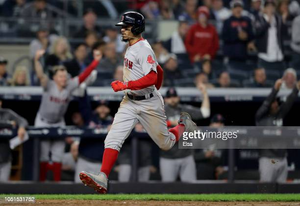 Mookie Betts of the Boston Red Sox scores a run of an RBI double hit by Andrew Benintendi against Lance Lynn of the New York Yankees during the...