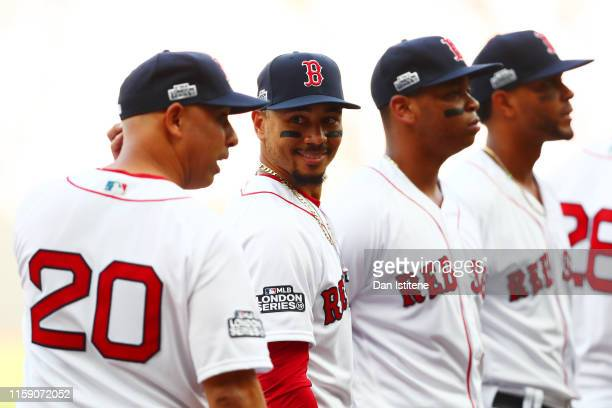 Mookie Betts of the Boston Red Sox speaks with manager Alex Cora of the Boston Red Sox before the MLB London Series game between Boston Red Sox and...