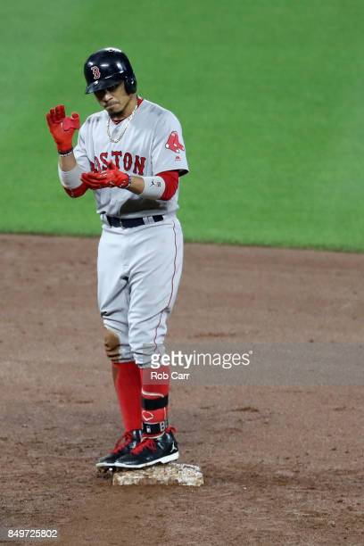 Mookie Betts of the Boston Red Sox stands on second base after hitting a three RBI double against the Baltimore Orioles at Oriole Park at Camden...