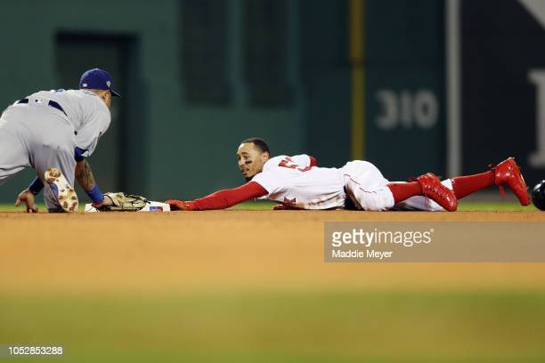 Mookie Betts of the Boston Red Sox steals second base during the first inning against Manny Machado of the Los Angeles Dodgersin Game One of the 2018...