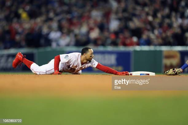 Mookie Betts of the Boston Red Sox steals second base during the first inning against the Los Angeles Dodgersin Game One of the 2018 World Series at...