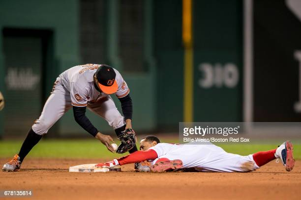 Mookie Betts of the Boston Red Sox steals second base to evade the tag of Jonathan Schoop of the Baltimore Orioles during the seventh inning of a...