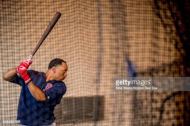 Mookie Betts of the Boston Red Sox takes swings in the batting cage before a Spring Training game against the Tampa Bay Rays on March 2 2017 at...