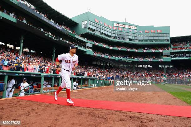 Mookie Betts of the Boston Red Sox takes the field before game three of the American League Division Series between the Houston Astros and the Boston...