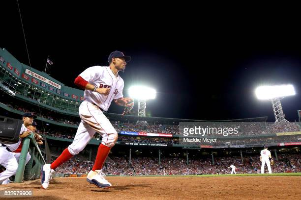 Mookie Betts of the Boston Red Sox takes the field during the sixth inning against the St Louis Cardinals at Fenway Park on August 16 2017 in Boston...