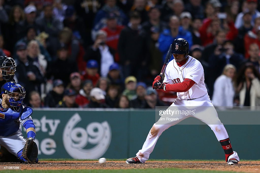 Mookie Betts #50 of the Boston Red Sox watches as Russell Martin #55 of the Toronto Blue Jays is unable to handle a wild pitch, allowing runner to advance in the ninth inning at Fenway Park April 27, 2015 in Boston, Massachusetts.