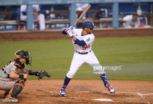 Mookie Betts of the Los Angeles Dodgers bats during the third inning against the San Francisco Giants in the Opening Day game at Dodger Stadium on...